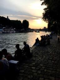Paris watching the sun go down along the Seine